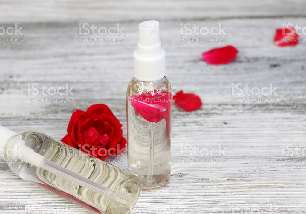 Rose water with a rose petal inside stock photo
