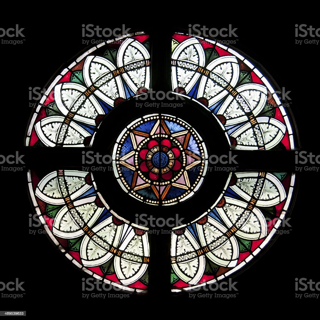 Rose window in stained glass stock photo