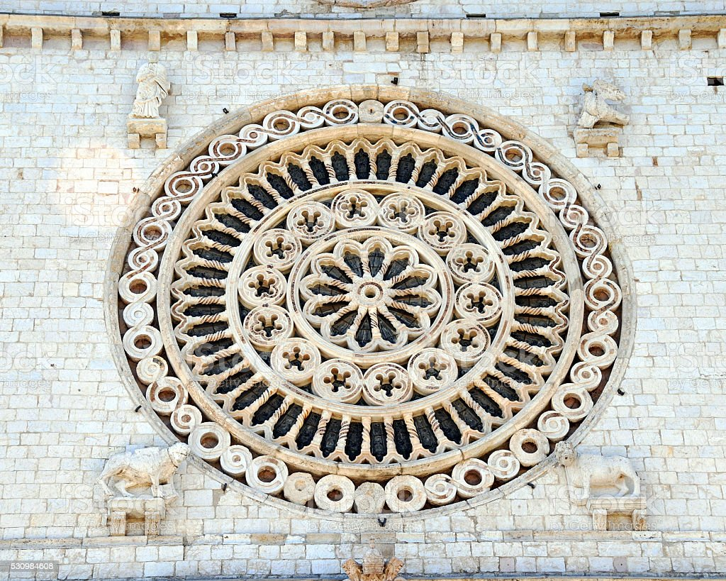 Rose window of the Basilica of San Francisco in Assisi,Italy stock photo