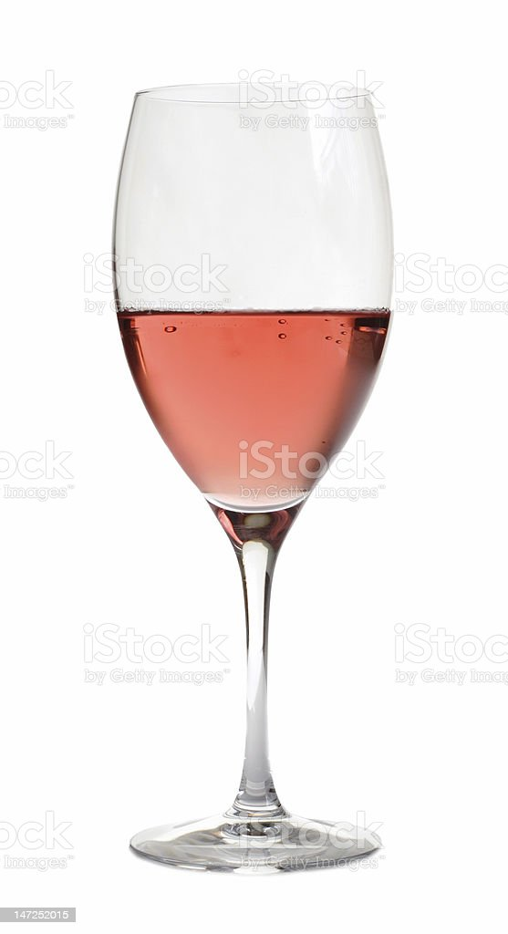 Rose wine in a crystal glass on a white background stock photo