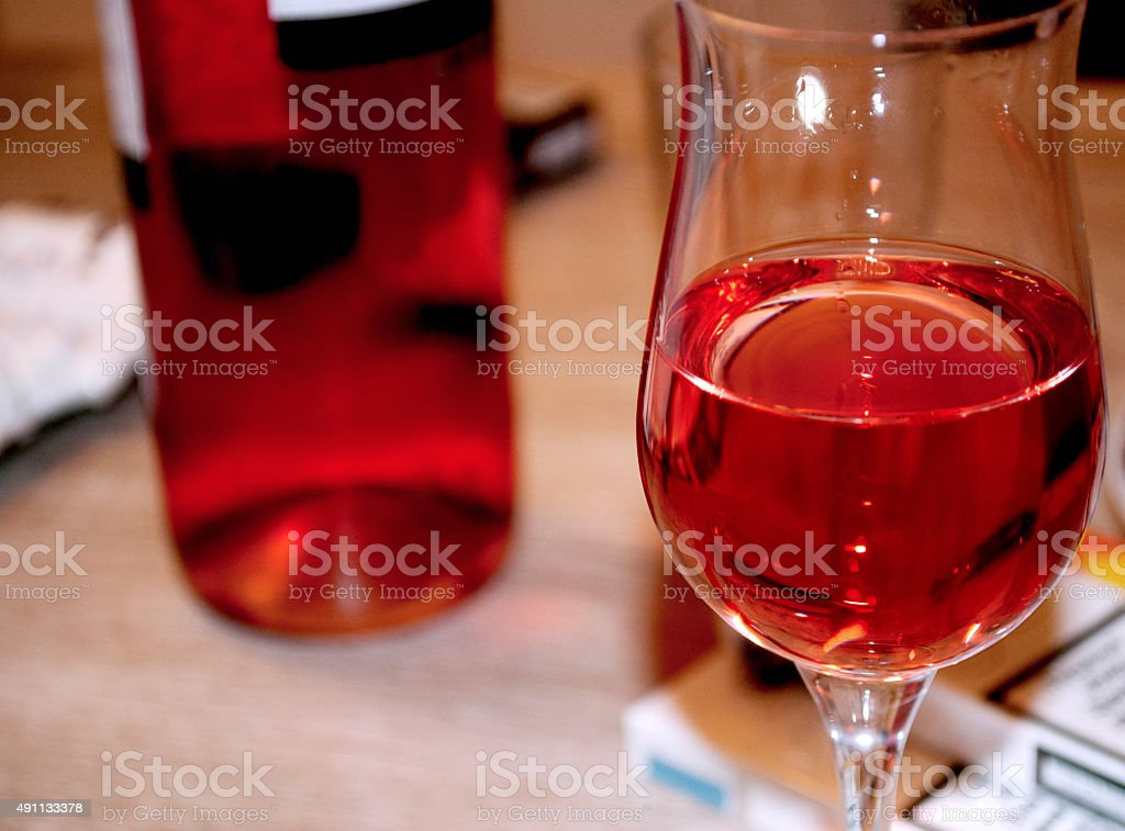 Rose wine in a glass stock photo