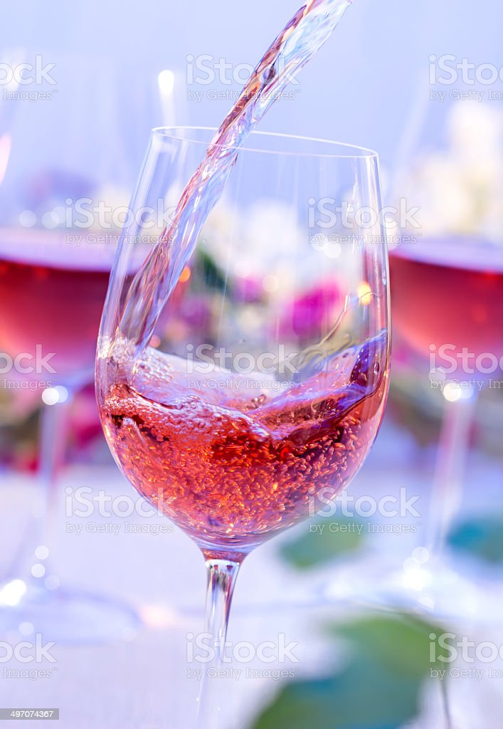 Rose wine poured outside stock photo
