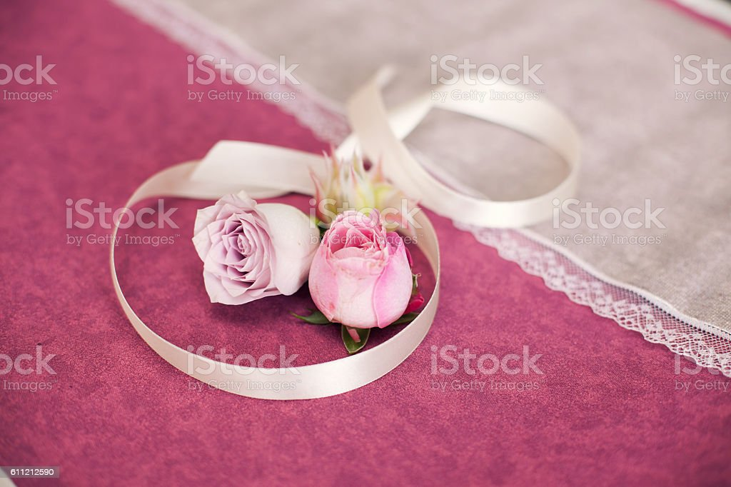 Rose with ribbon on a lilac background. stock photo
