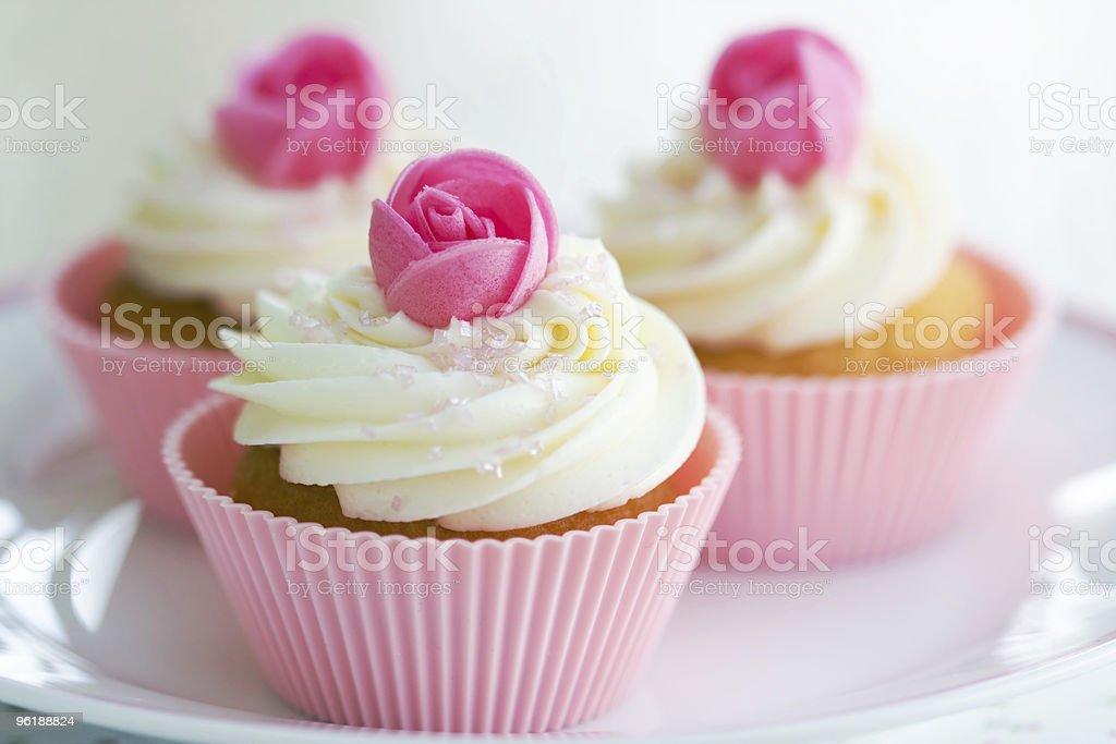 Rosebud cupcakes stock photo