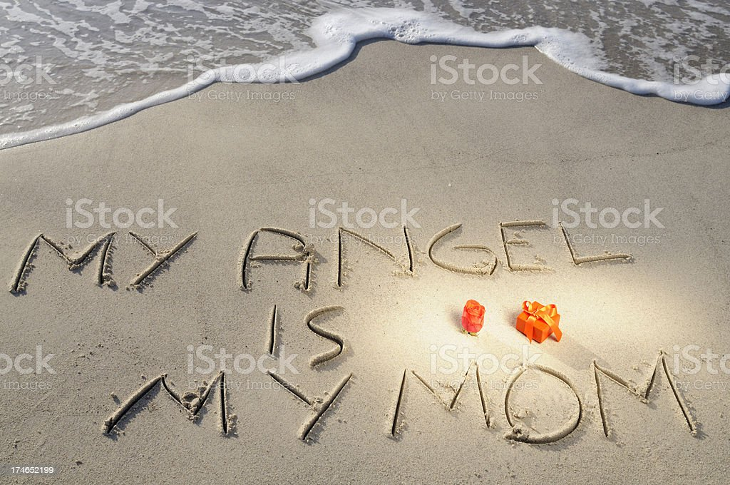 Rose,Gift and Words Written in Sand on Mothers Day royalty-free stock photo