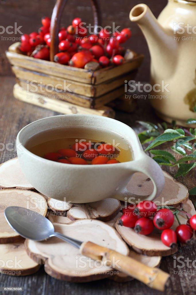 Rosehip tea and berries in basket stock photo