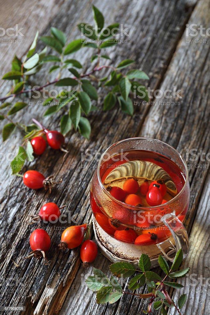 Rosehip tea and berries stock photo