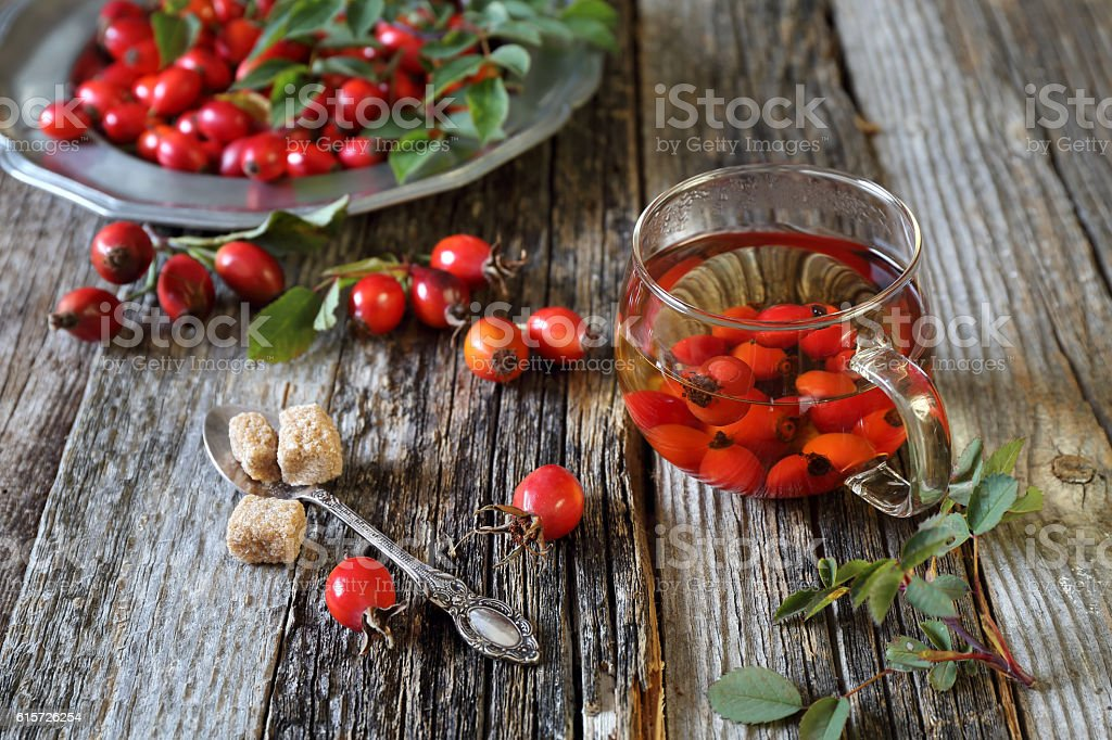 Rosehip tea in glass cup and berries stock photo