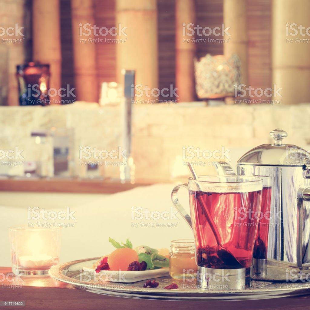Rosehip tea near jacuzzi. Valentines background. Romance concept. Health concept stock photo