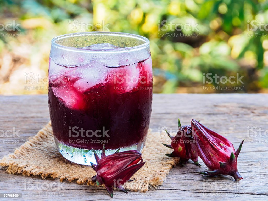 Roselle water side view on wooden table stock photo