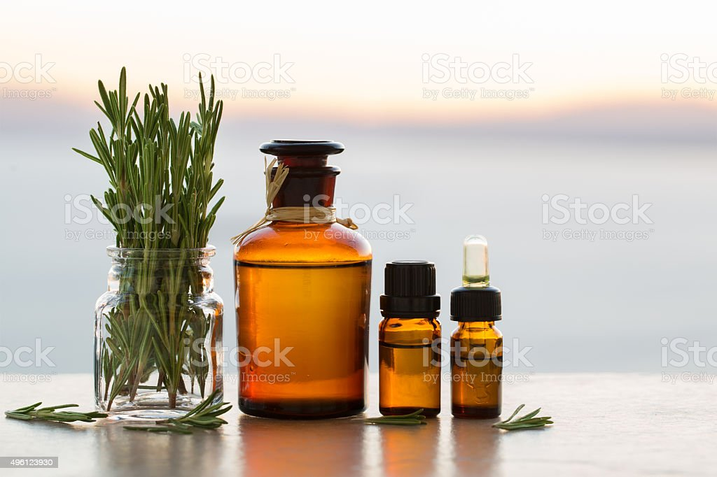 Rosemary aromatherapy essential oils in bottles stock photo