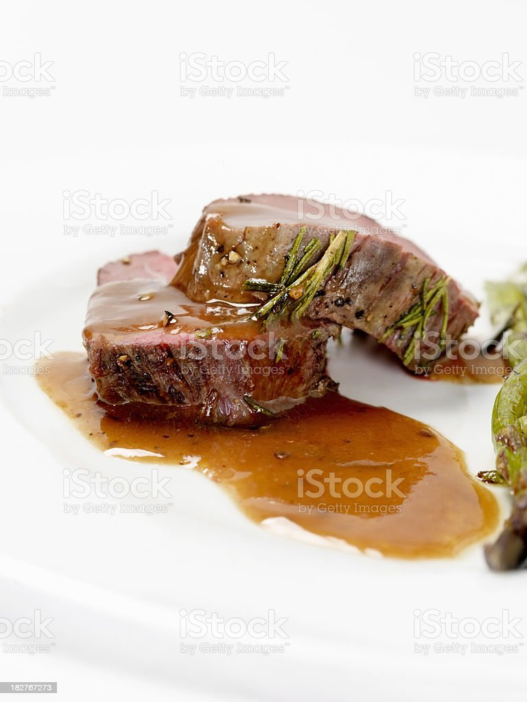 Rosemary Beef Tenderloin with Asparagus and Gravy stock photo
