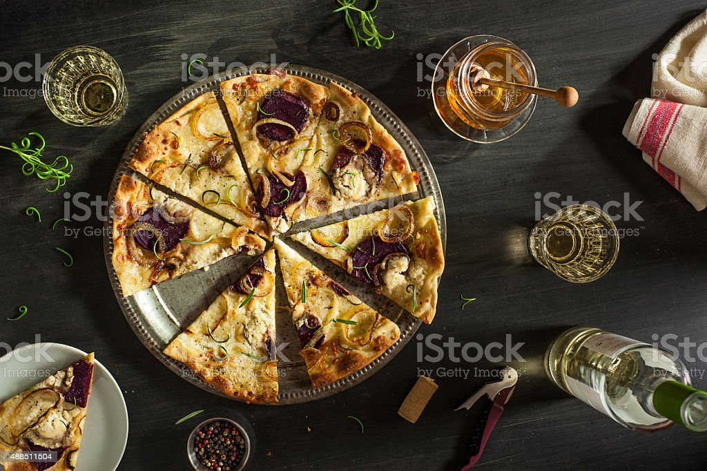 Rosemary, Beet, Goat Cheese, and Caramelized Onion Pizza stock photo