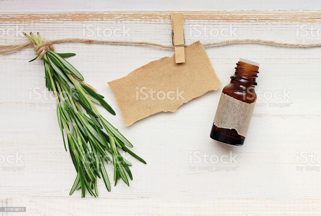 Rosemary, bottle, note pinned stock photo