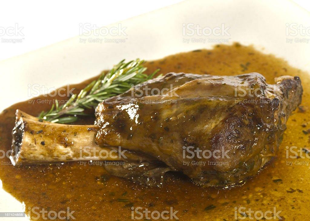 Rosemary Lamb shank on mint sauce stock photo