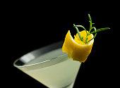 Rosemary Lemontini cocktail isolated on black