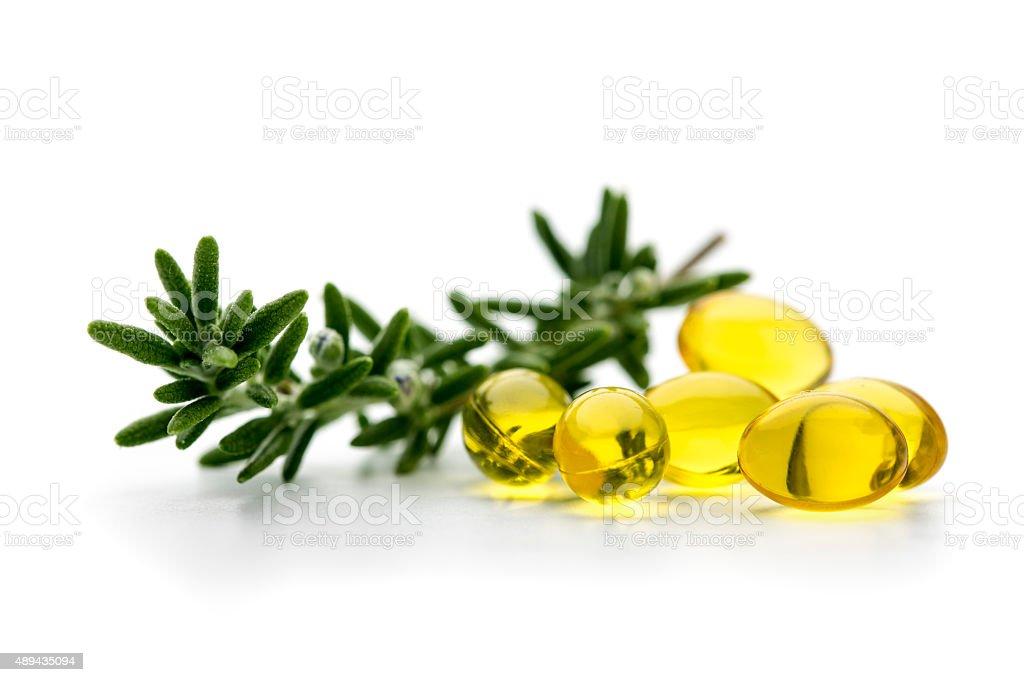Rosemary oil supplementary capsules stock photo
