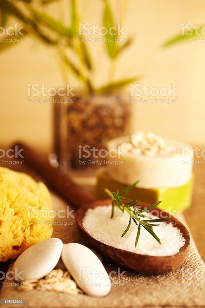 Rosemary on bath salt scrub in wooden spoon and soap stock photo