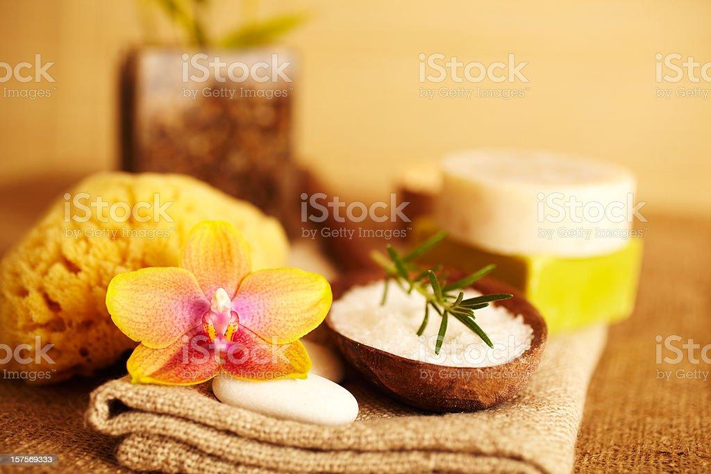 Rosemary on bath salt scrub in wooden spoon royalty-free stock photo