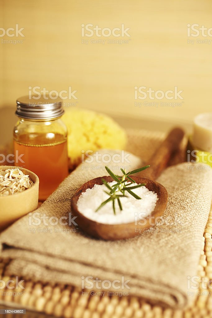 Rosemary on bath salt scrub in wooden spoon royalty-free stock photo