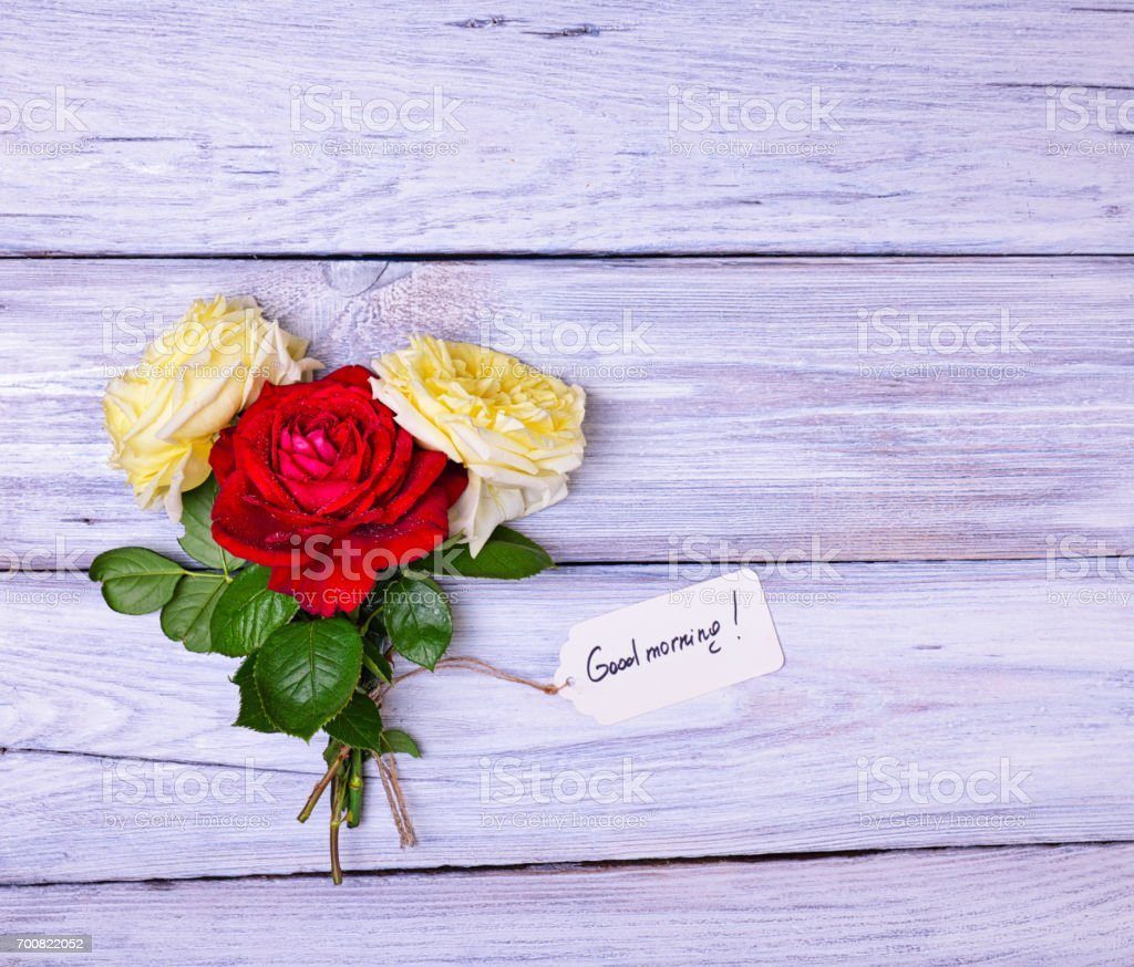 roses and a paper tag with an inscription good morning stock photo