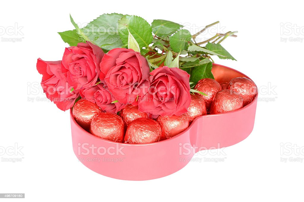 Roses and candies to holiday stock photo