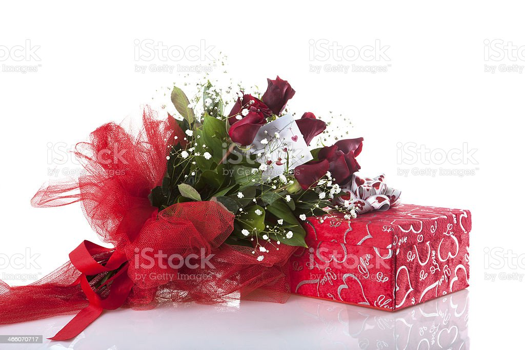 roses and gift on white stock photo