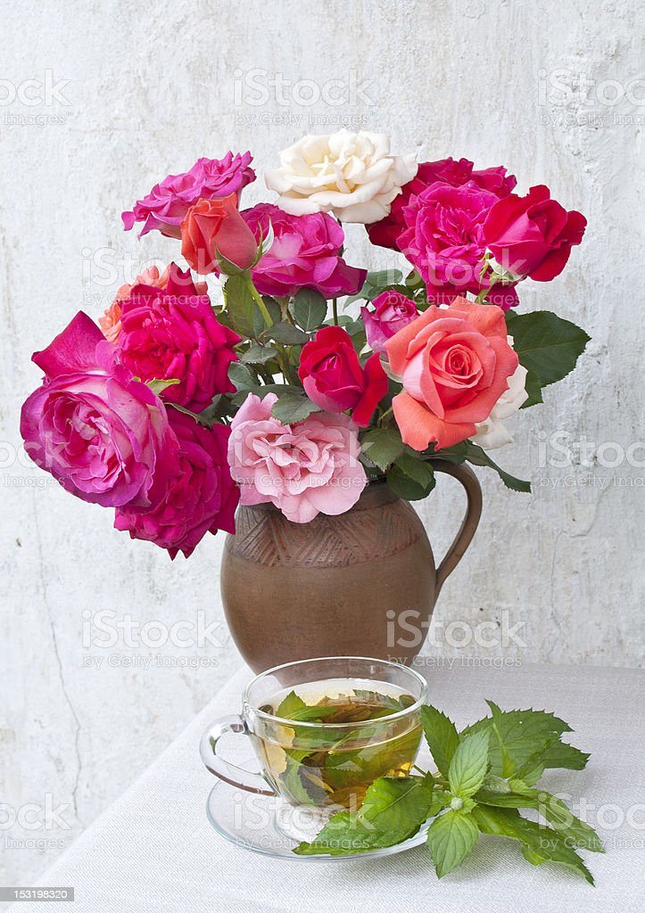 roses and green mint tea still life at table royalty-free stock photo