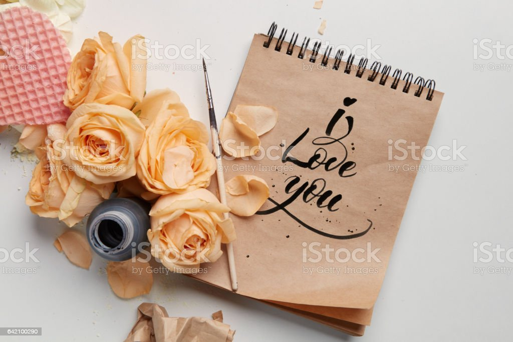 Roses and heart with notebook stock photo