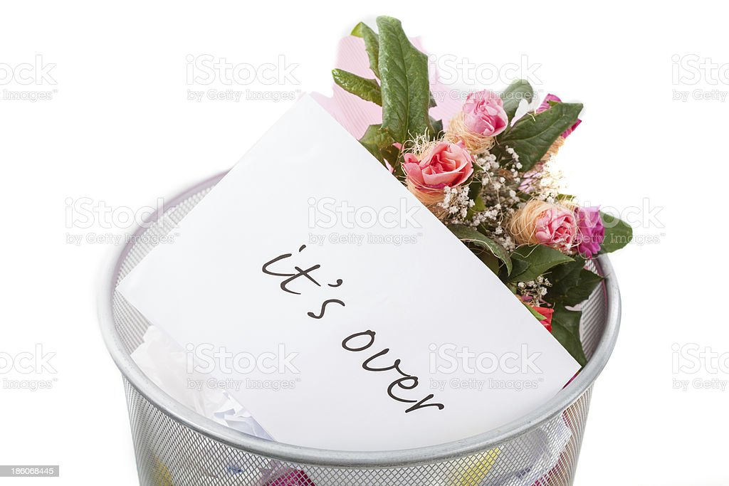 Roses and it's over note in dustbin royalty-free stock photo