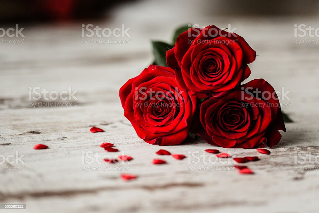 Roses and little hearts on wooden background stock photo