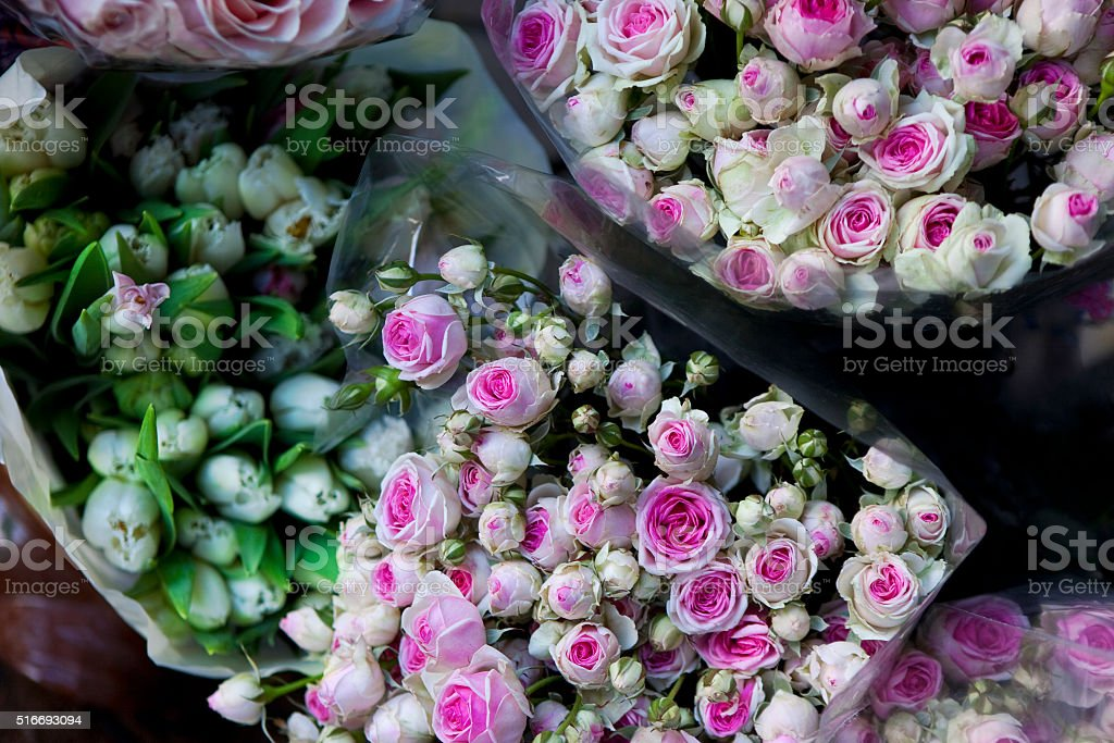 Roses and tulips stock photo