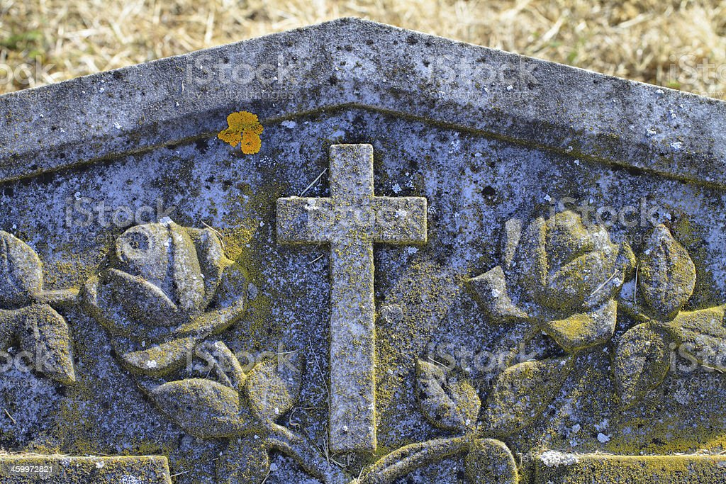 Christian cross with roses on headstone royalty-free stock photo