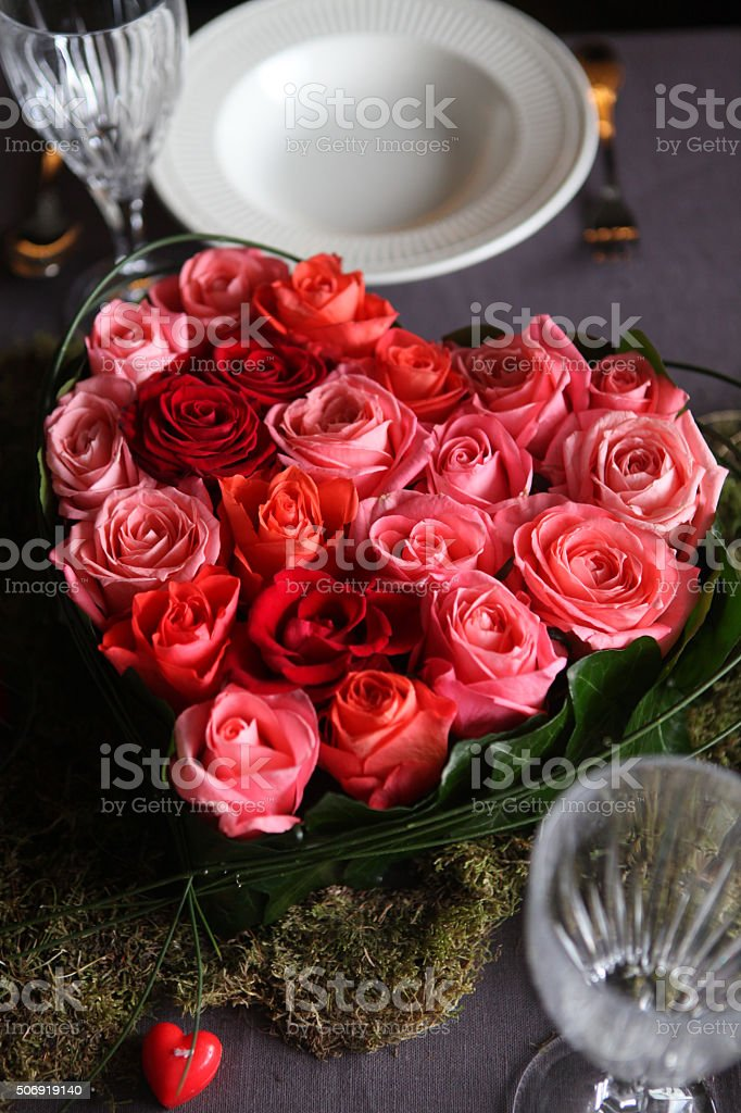 Roses bouquet in heart shape stock photo