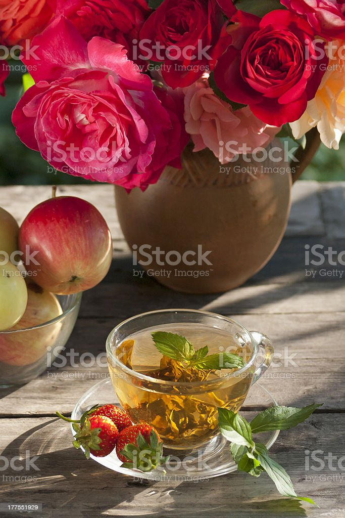 roses green mint tea, strawberry and apples royalty-free stock photo