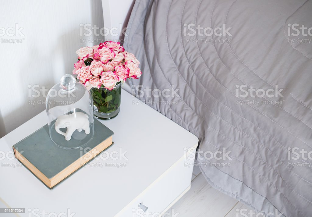 roses in a bedroom stock photo