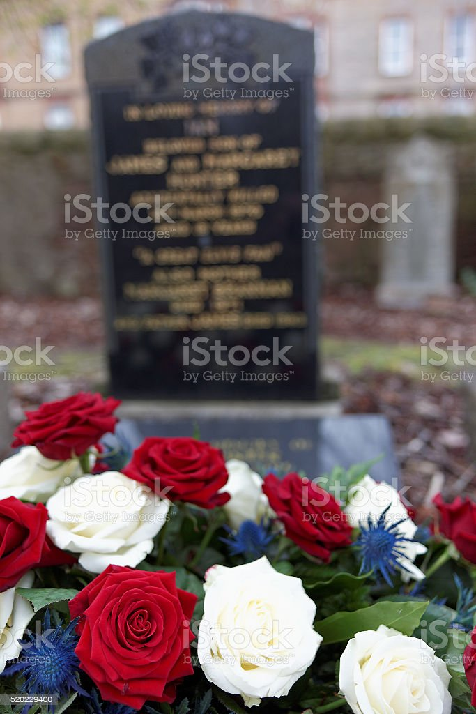 Roses in wreath on grave stock photo