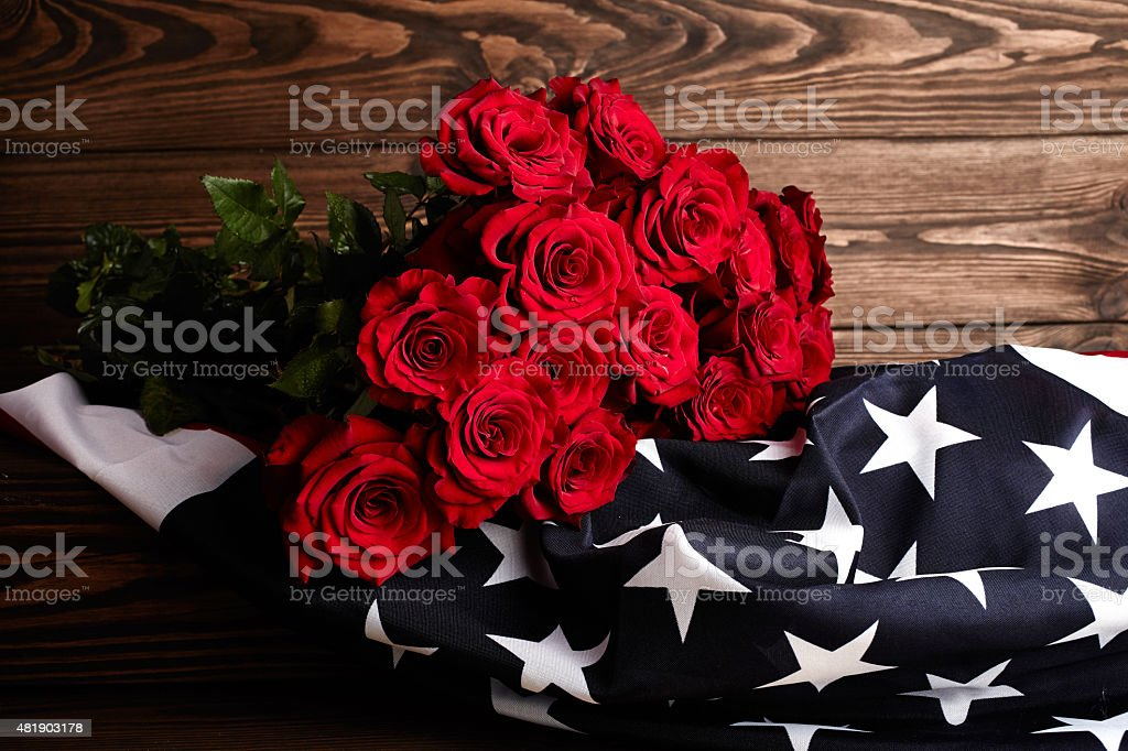 Roses on american flag. Memory stock photo