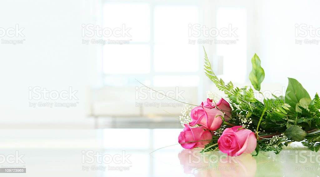 Roses on Glass Table royalty-free stock photo