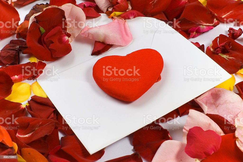 roses petals, heart and envelope stock photo