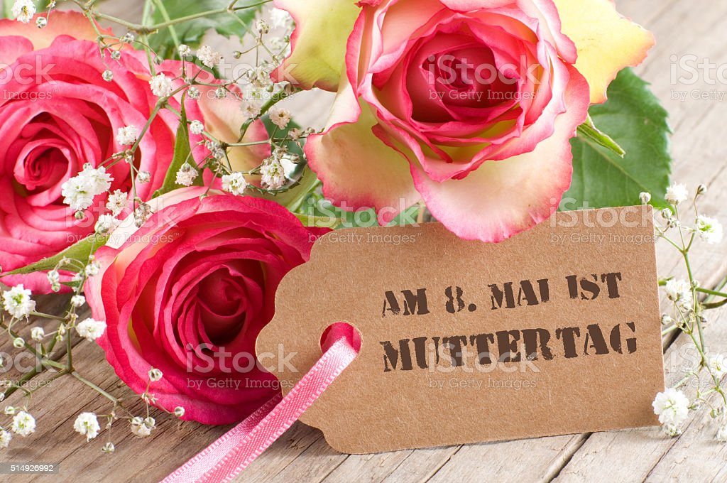Roses with paper tag on weathered wood stock photo