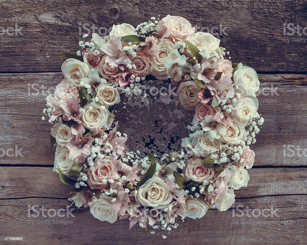 Roses wreath on wooden background. stock photo