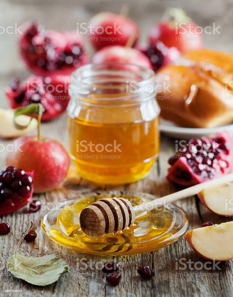 Rosh Hashana, Jewish New Year Holiday, honey, apple, pomegranate, hala stock photo