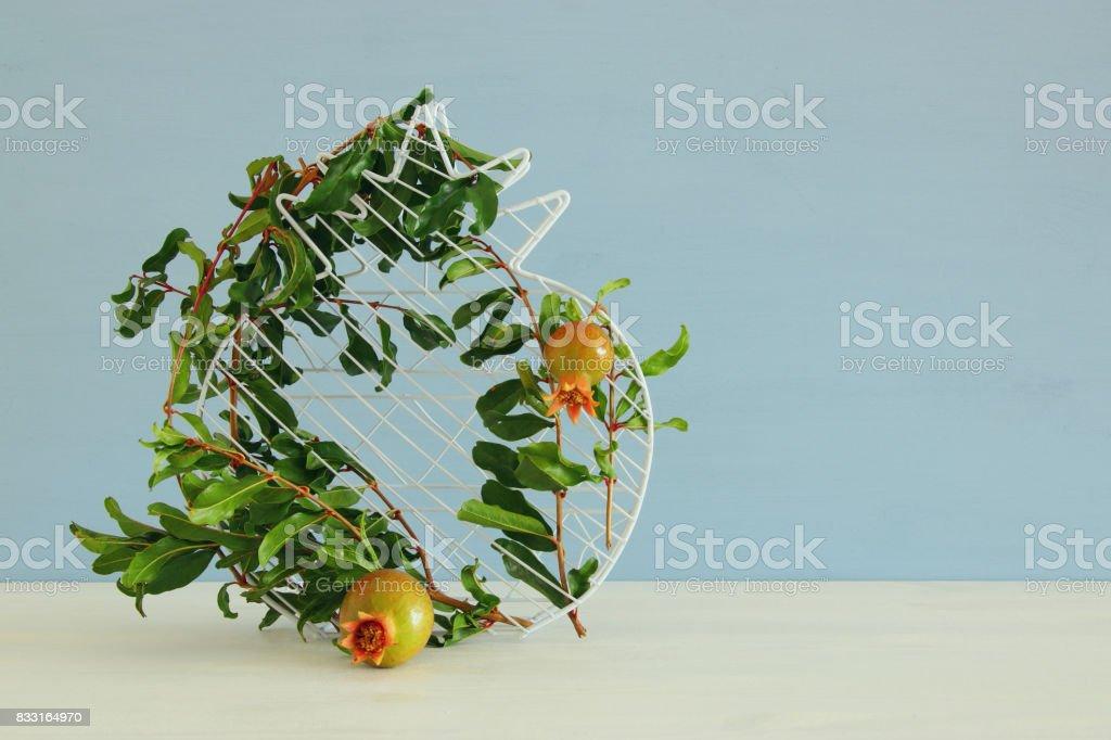 Rosh hashanah (jewesh New Year holiday) concept - pomegranate. Traditional symbol stock photo