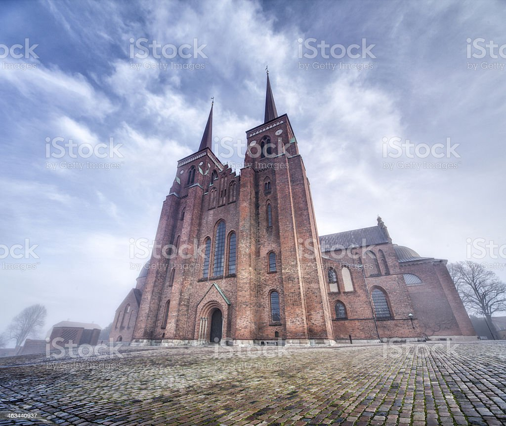 Roskilde Cathedral on a foggy day stock photo