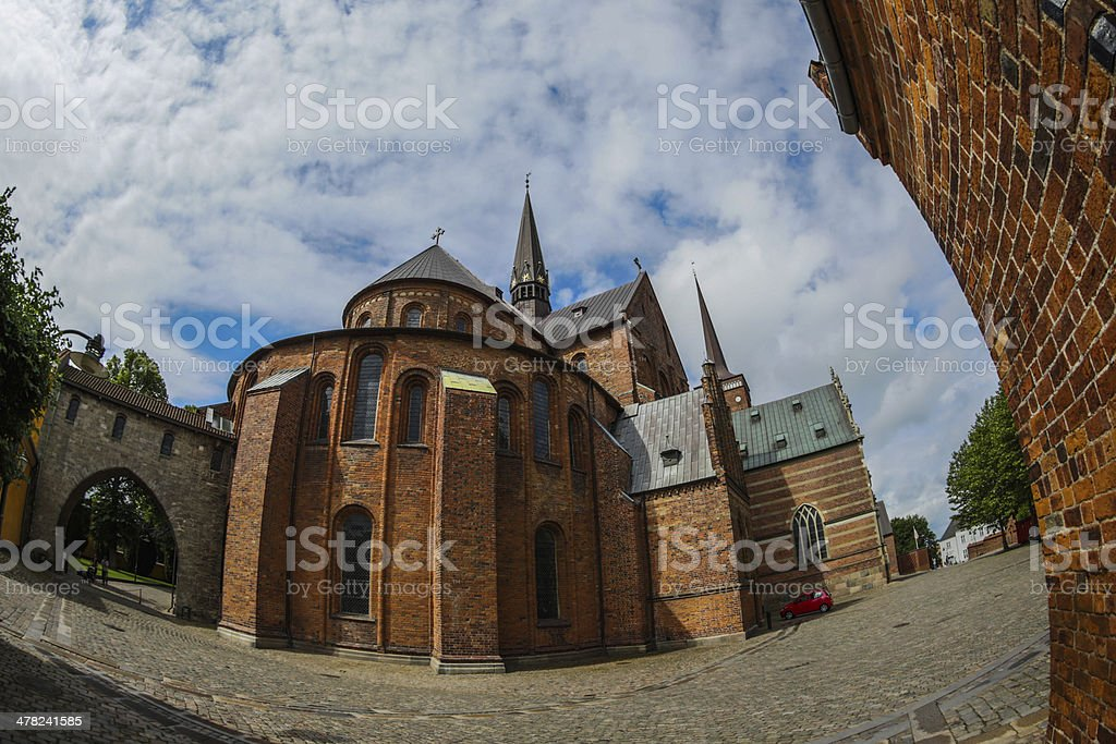 Roskilde cathedral with bishop Absalon's arch to the left. stock photo