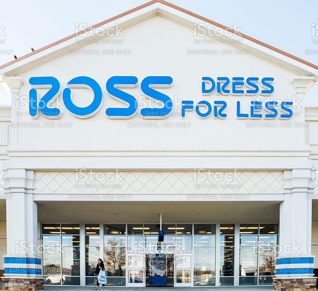 Ross storefront with hanging blue sign and person walking stock photo