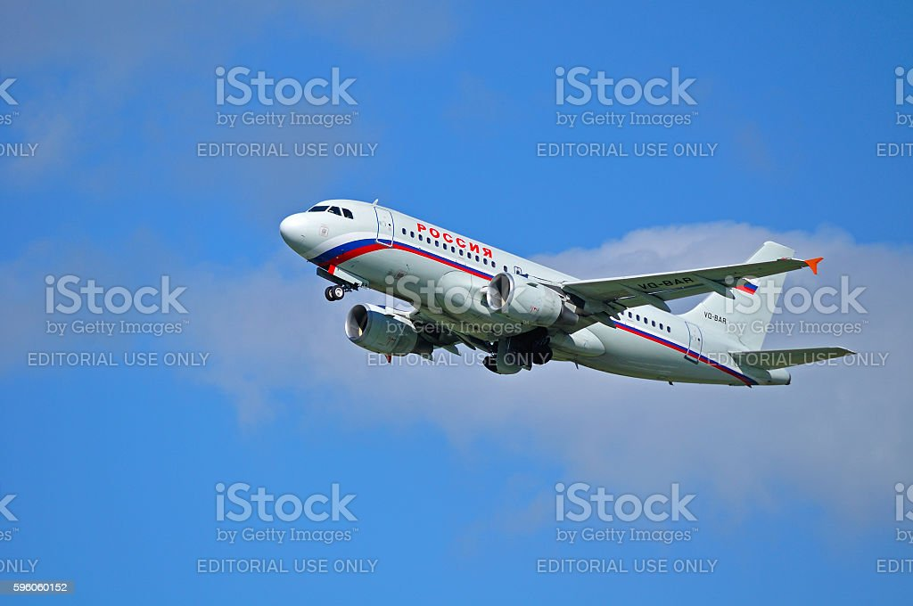 Rossiya Airlines Airbus A319 airplane is flying in the sky stock photo