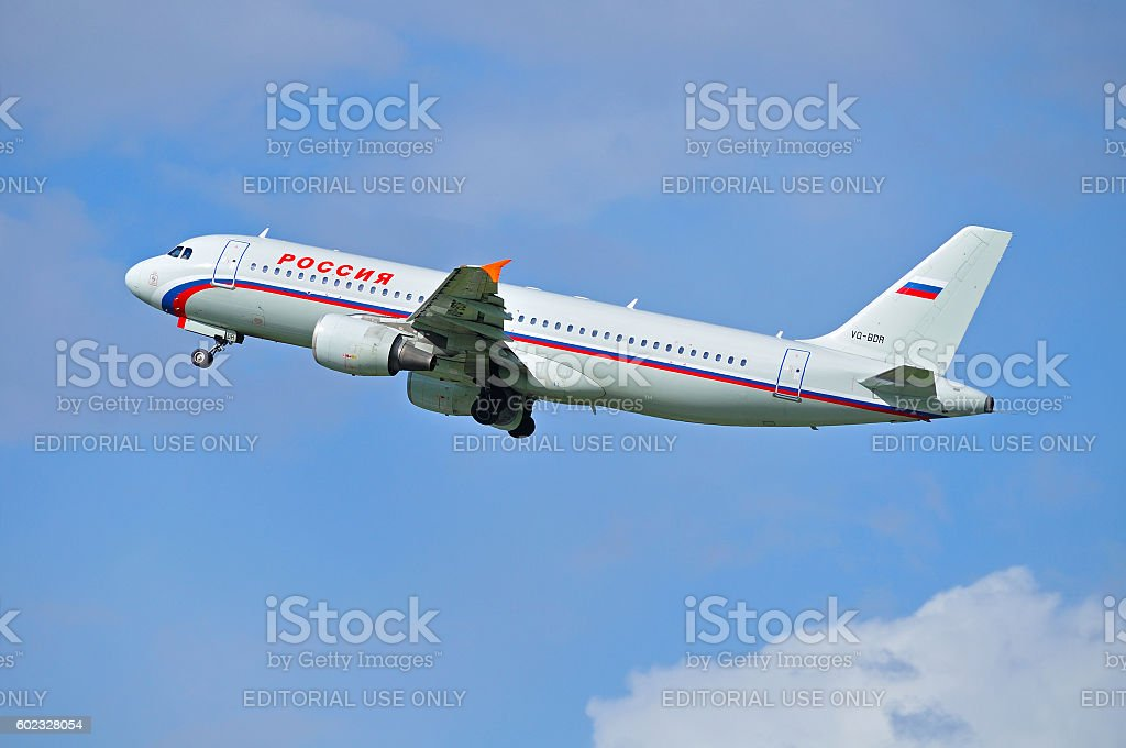 Rossiya Airlines Airbus A320 airplane is flying in the sky stock photo