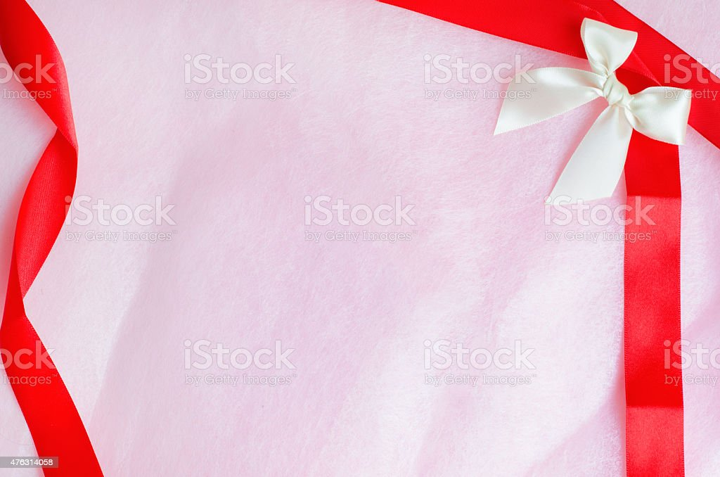 Rosy pink paper texture background with ribbon and bow stock photo